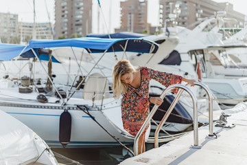 The girl in the port. private yachts in port. sunny day. Spain, Malaga