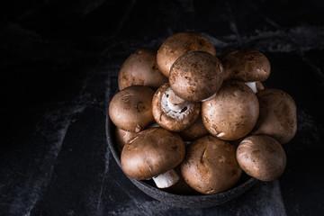 Harvest of mushrooms in plate. Selective focus. Royal champignon. Vegan. Vegetarian food, Vitamin. Healthy food. Process of cooking.