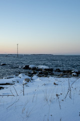 Beautiful winter view of baltic sea with snow and cold water