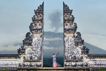 Aluminium Prints Bali Man is standing in the gate of Lempuyang temple on Bali isalnd, Indonesia