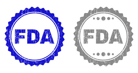 Grunge FDA stamp seals isolated on a white background. Rosette seals with grunge texture in blue and grey colors. Vector rubber stamp imprint of FDA label inside round rosette.