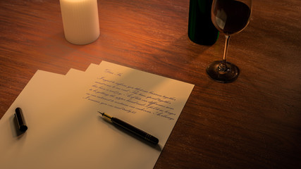 Writing a letter concept with wine and candle