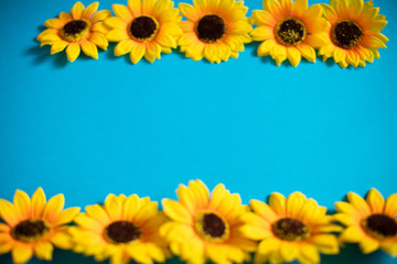 Artificial sunflowers of blue background with copy space