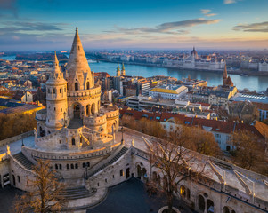Printed roller blinds Budapest Budapest, Hungary - The main tower of the famous Fisherman's Bastion (Halaszbastya) from above with Parliament building and River Danube at background on a sunny morning