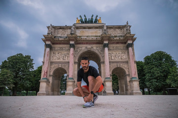 Man running in Paris near Louvre and Eiffel tower