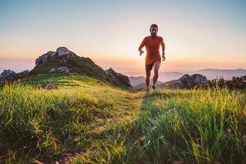 Foto auf Acrylglas Grau Verkehrs Man trail running on a mountain at the dask
