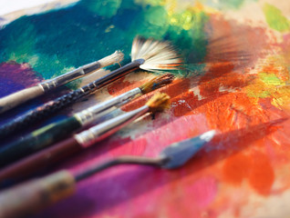 Drawing tools on the palette are illuminated by the sun, which is scattered strokes