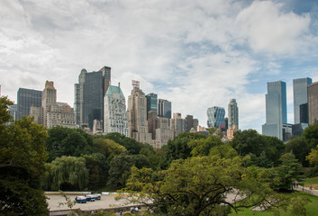 Panoramic view from Central Park to Manhattan skyscrapers at sunny day. New York City
