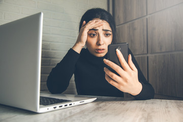 sad woman hand phone in office desk