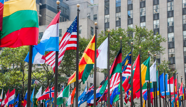 Rows of flags of all nations next to UN in New York City. Usa