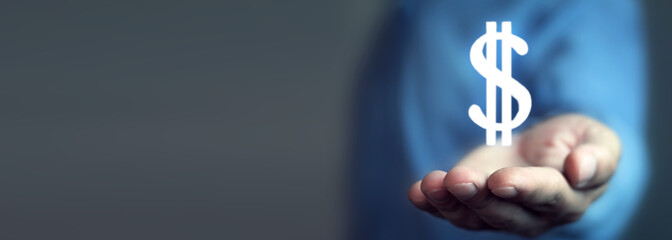 Man hand holding dollar sign.