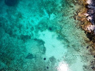 top view of rocky shore crystal clear Adriatic Sea, drone shot