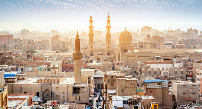 CAIRO, EGYPT - OCTOBER 12, 2018: Panorama of the medieval Bab Zuweila gate located in the heart of Islamic Cairo and surrounded by noisy Arab souq (market), on October 12 in Cairo.