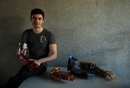 David Aguilar poses with his prosthetic arms built with Lego pieces during an interview with Reuters in Sant Cugat del Valles