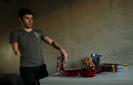 David Aguilar shows his prosthetic arms built with Lego pieces during an interview with Reuters in Sant Cugat del Valles