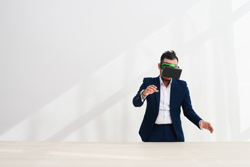 Businessman working in virtual reality glasses