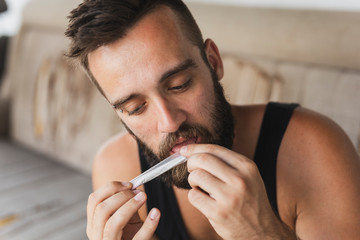 Man licking a joint