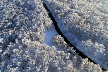 aerial drone view with road and winter forest