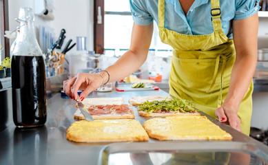 Woman preparing sandwich