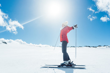 Woman enjoying her winter vacation on ski