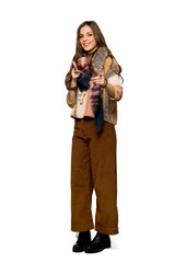 Full-length shot of Young hippie woman pointing to the front and smiling on isolated white background