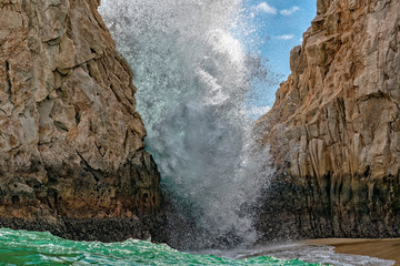 waves on lava rocks in cabo san lucas mexico