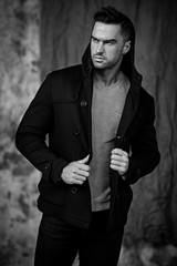 Black and white image of male model in jacket