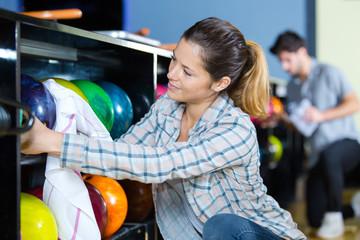 pretty woman cleaning bowling balls