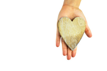 Wooden heart in hand.Place for text.