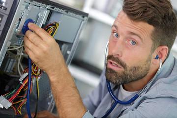 repairman fixing computer