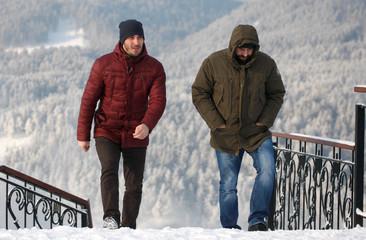 Men walk upstairs on a cold winter day outside Krasnoyarsk