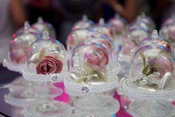 Elegant gifts made of glass with a rose
