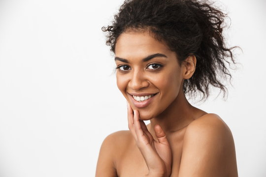 Happy young african woman posing isolated over white wall background.