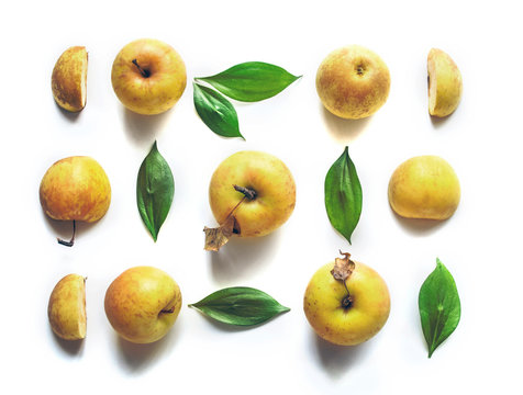 Fresh yellow apples Golden on a white background with leaves.  Autumn  the composition. Isolated objects.Top view. Minimal concept.