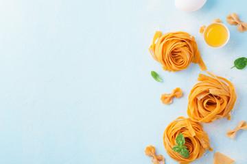 Fresh uncooked homemade pasta tagliatelle or fettuccine.