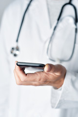 doctor man using a smartphone