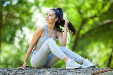 Young girl posing outdoor in her sportswear