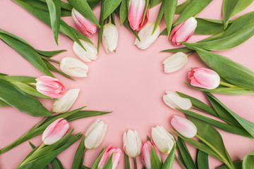 top view of circle frame with pink and white spring tulips isolated on pink