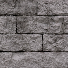 old wet brick wall in grey