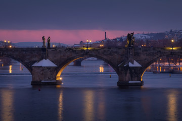 Detail view on illuminated Charles bridge at winter dusk, Prague