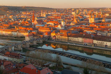 Historic city of Wurzburg at the sunset with bridge Alte Mainbrucke, Germany.