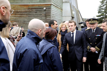 French Labour Minister Muriel Penicaud and French president Emmanuel Macron meet with teachers and students as they visit an EPIDE school in Etang-sur-Arroux