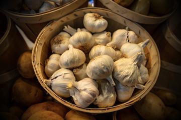 Basket of garlic bulbs at the market
