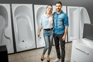 Couple choosing new bathtub in the shop