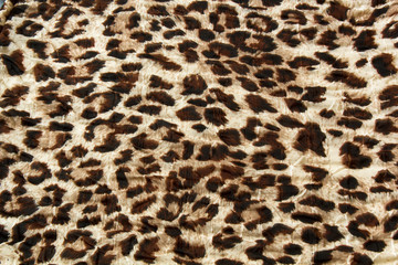 Fashion trendy fabric pattern with leopard skin print background