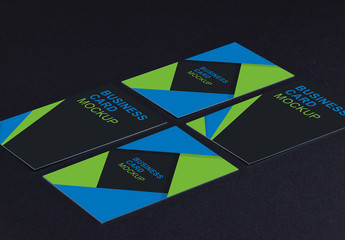 Four Business Cards on a Dark Background Mockup
