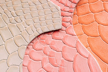 Genuine leather, colorful samples in a different colors, embossed under the skin reptile. Texture pattern for background