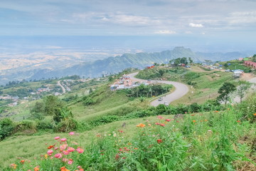 view morning of curve road on the hill with green hill and blue sky background, Phu Thap Boek, Phetchabun, Thailand.