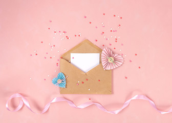 Paper hearts in scrapbooking technique fly out of craft paper envelope on the Living Coral background . Valentine day. love concept. Gift, message for lover. Space for text. Wide banner - Image.