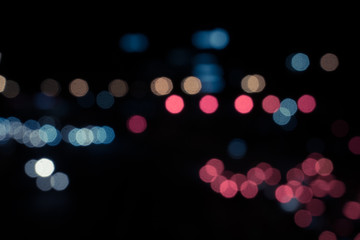 Abstract blurred background of city light. Out of focus traffic light background.